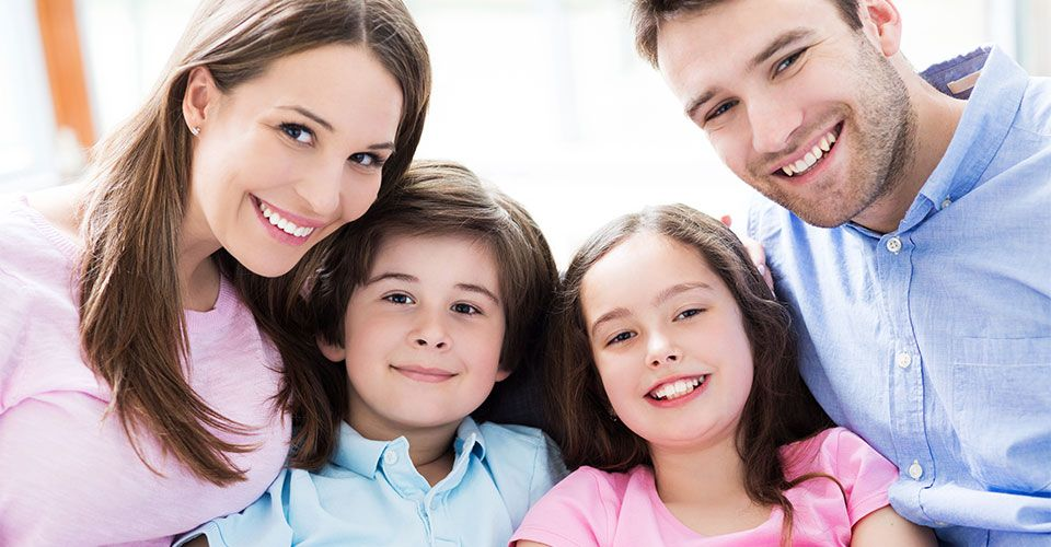 parents with kids smiling